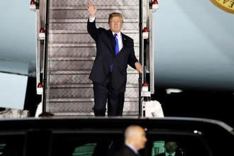 Президент США Дональд Трамп после прибытия в Сингапур, 10 июня 2018 года