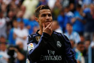Нападающий мадридского «Реала» Криштиану Роналду в матче против «Малаги» в заключительном туре чемпионата Испании