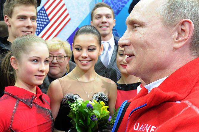 Президент России Владимир Путин и Юлия Липницкая на XXII зимних Олимпийских играх в Сочи, 9 февраля 2014 года