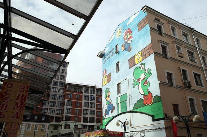Граффити на доме на Новослободской улице