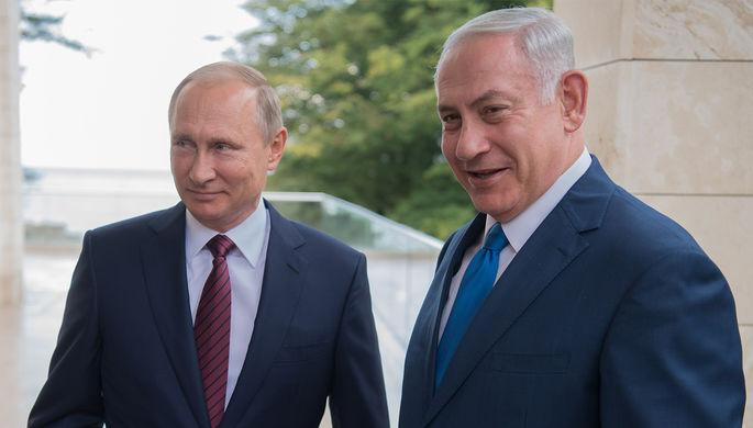 Президент РФ Владимир Путин и премьер-министр Израиля Биньямин Нетаньяху во время встречи в Сочи, 23...