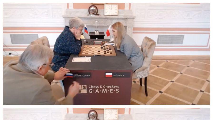 В финальном матче на первенство мира по шашкам польские организаторы забирают российскую символику возле Тамары Тансыккужиной