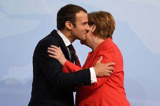 Президент Франции Эммануэль Макрон и канцлер Германии Ангела Меркель на саммите G20 в Гамбурге, 7 июля 2017 года