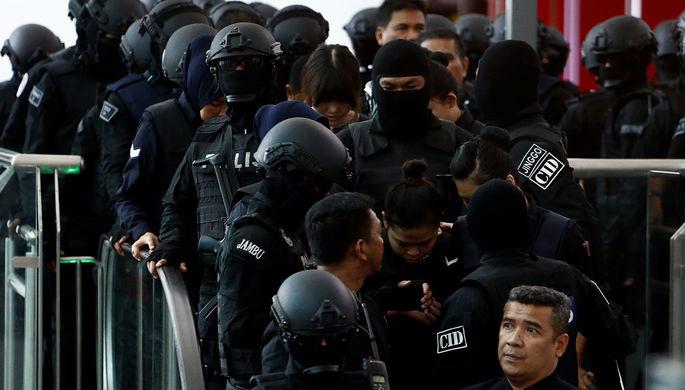 Подозреваемые в убийстве Ким Чон Нама гражданка Индонезии Сити Айсиа и гражданка Вьетнама Доан Тхи...