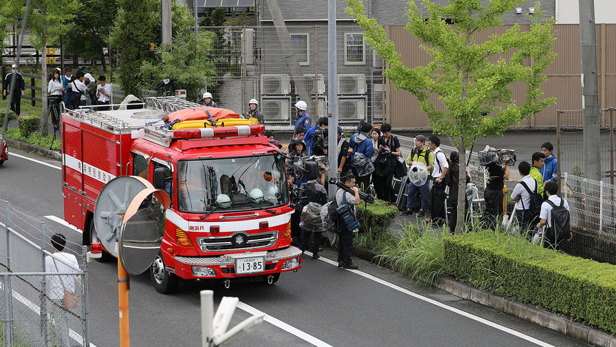 Работа экстренных служб на месте пожара в здании мультипликационной студии Kyoto Animation Co. в японском Киото, 18 июля 2019 года