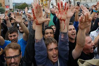 В день референдума в Каталонии в столкновениях с полицией пострадало более 400 человек