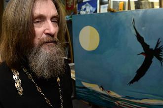 Федор Конюхов с одной из своих картин, 2014 год