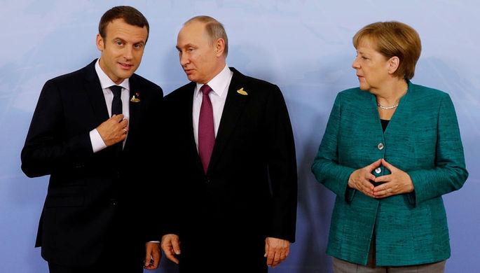 Президент Франции Эммануэль Макрон, президент России Владимир Путин и канцлер Германии Ангела...