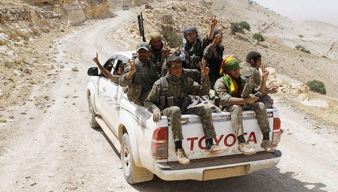 Бойцы курдских вооруженных формирований (YPG) на севере Сирии