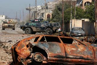 Иракские силы безопасности во время боев в западной части Мосула, 6 марта 2017 года