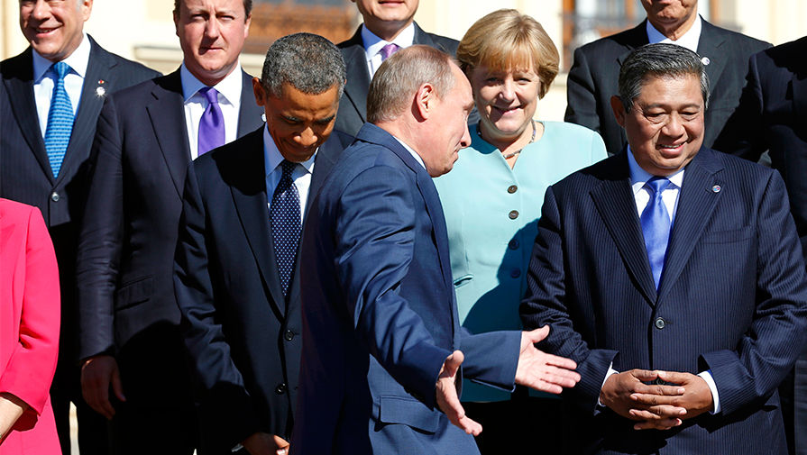Президент США Барак Обама, президент России Владимир Путин и канцлер ФРГ Ангела Меркель на саммите G20 в Санкт-Петербурге, сентябрь 2013 года