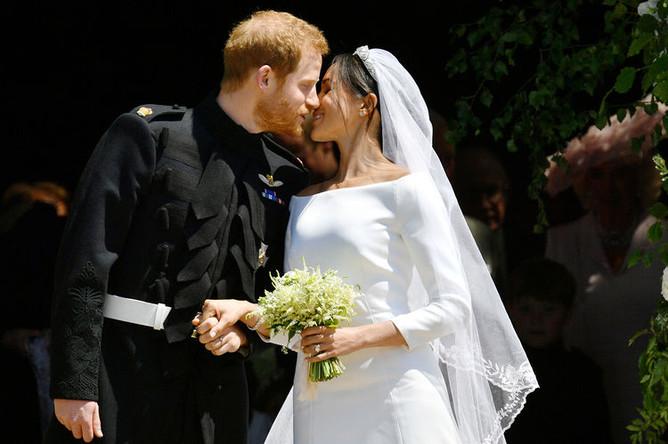 Принц Гарри и Меган Маркл на свадебной церемонии в часовне Святого Георгия в Виндзорском замке, 19 мая 2018 года