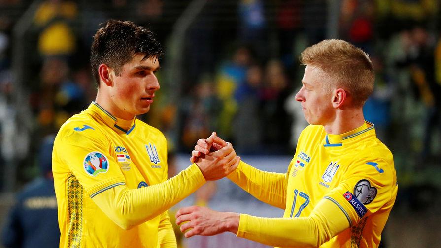 Футболисты сборной Украины Руслан Малиновский и Александр Зинченко