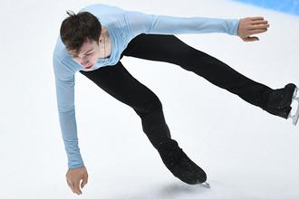 Дмитрий Алиев выступает в произвольной программе мужского одиночного катания на чемпионате России по фигурному катанию в Санкт-Петербурге, 22 декабря 2017 года