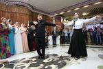 Рамзан Кадыров танцует содной извыпускниц во время торжественного ужина, который он дал водном иззданий нового правительственного комплекса вГрозном, вчесть лучших выпускников школ и вузов Чечни, 2013год