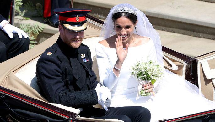 Принц Гарри и Меган Маркл на свадебной церемонии в часовне Святого Георгия в Виндзорском замке, 19...