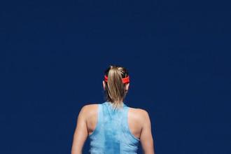 Россиянка Мария Шарапова во время матча Открытого чемпионата Австралии против Эшли Барти
