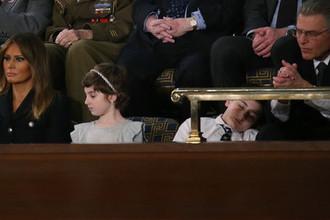 11-летний школьник из Делавэра Джошуа Трамп и первая леди США Меланья Трамп во время речи президента Дональда Трампа «О положении страны» в Вашингтоне, 5 февраля 2019 года