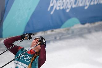 Российская спортсменка Юлия Белорукова после финиша спринта среди женщин в полуфинальных соревнованиях по лыжным гонкам на Олимпиаде в Пхенчхане, 13 февраля 2018 года