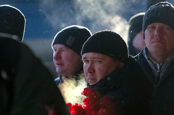 Во время церемонии прощания с жертвами взрыва и обрушения в жилом доме в Магнитогорске, 4 января 2019 года