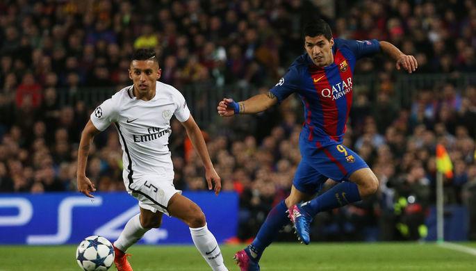 Нападающий «Барселоны» Луис Суарес (справа) в борьбе с защитником «ПСЖ» Маркиньосом