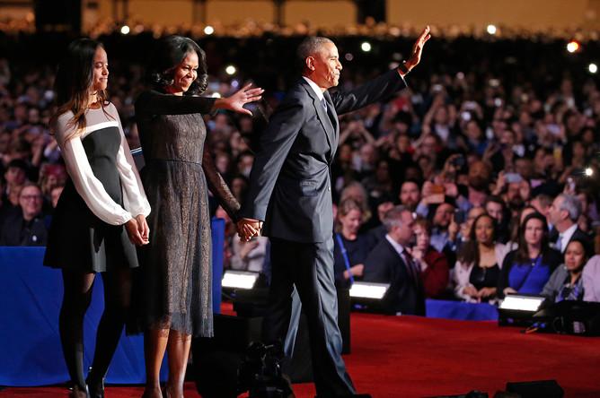 Барак и Мишель Обама и их старшая дочь Малия