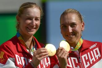 Для Екатерины Макаровой (слева) и Елены Весниной год сложился удачно, но главным событием стала победа на Олимпиаде