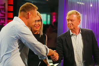 Алексей Навальный, Ксения Собчак и Анатолий Чубайс во время дебатов на телеканале «Дождь» в прямом эфире