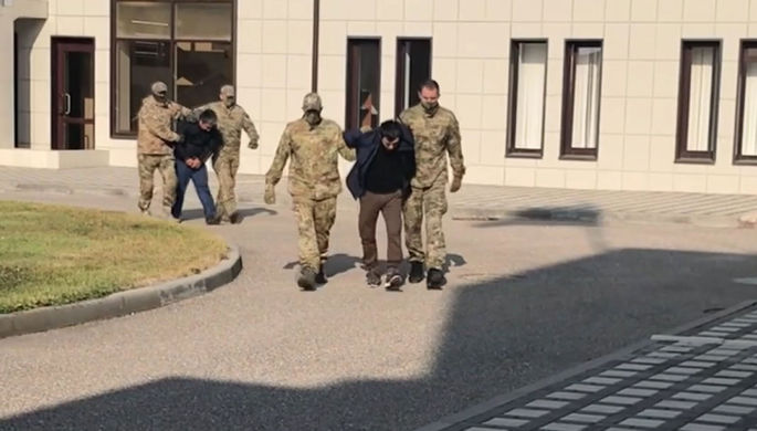 Сотрудники ФСБ в момент задержания участников вооруженного нападения в августе 1999 года в составе бандформирований Басаева и Хаттаба на населенные пункты Ботлихского района республики Дагестан, октябрь 2020 года