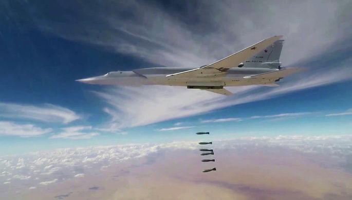 Скриншот из видео ударов бомбардировщиков Ту-22М3 ВКС России по объектам в Сирии. Кадры опубликованы...