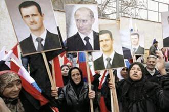 Сирийцы с портретами Владимира Путина и Башара Асада в Дамаске на митинге 15 сентября 2013 года