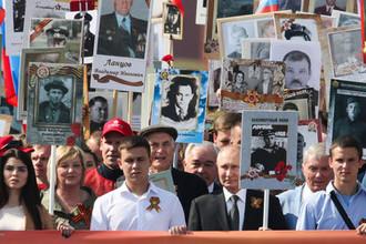 Президент России Владимир Путин во время акции памяти «Бессмертный полк» на Красной площади, 9 мая 2019 года