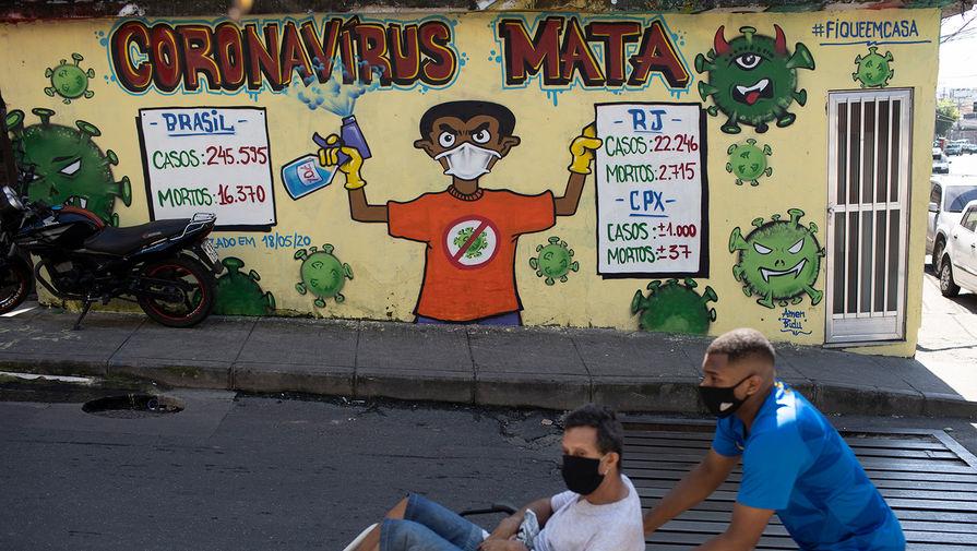 Статистика летальных случаев от Covid-19 на одной из улиц в Рио-де-Жанейро, Бразилия,