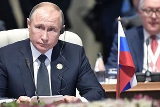 Президент России Владимир Путин во время встречи лидеров БРИКС в Йоханнесбурге, ЮАР, 26 июля 2018 года