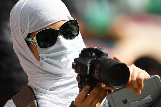 Болельщица из Саудовской Аравии перед матчем группового этапа чемпионата мира по футболу между сборными России и Саудовской Аравии