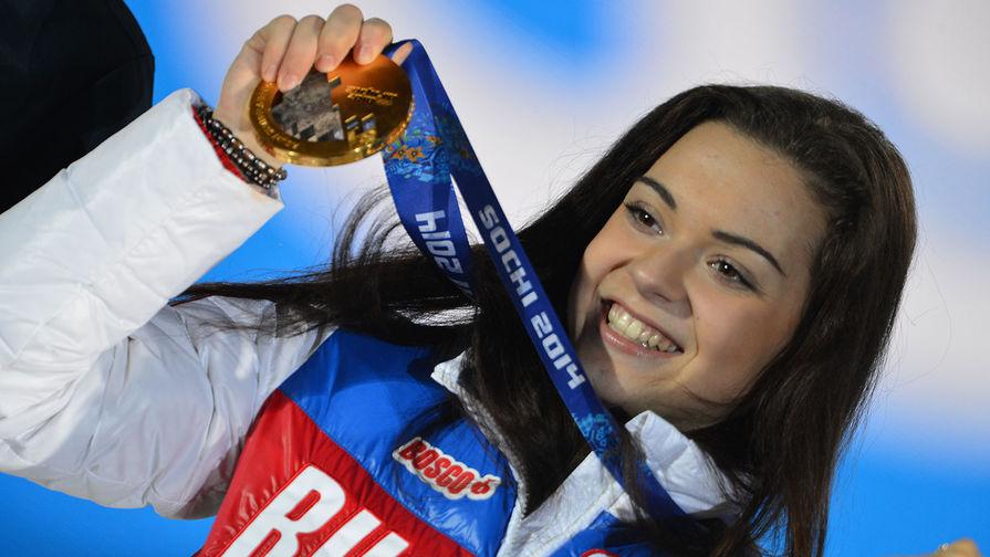 Аделина Сотникова, завоевавшая золотую медаль на соревнованиях по фигурному катанию в женском одиночном катании на XXII зимних Олимпийских играх в Сочи, 2014 год