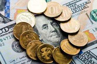 Доллар по 70: рубль прогнется под грузом санкций
