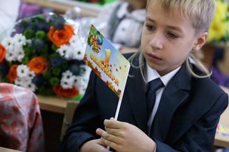 Учащийся московской гимназии №1551 в первый день нового учебного года
