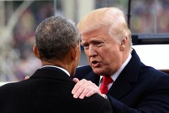 Бывший и действующий президенты США Барак Обама и Дональд Трамп во время инаугурации в Вашингтоне, 20 января 2017 года