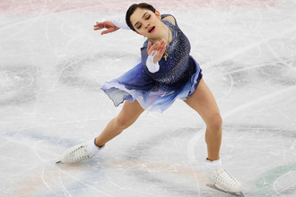Российская фигуристка Евгения Медведева во время выступления в короткой программе в командного олимпийского турнира, 11 февраля 2018 года