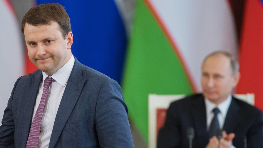 Министр экономического развития России Максим Орешкин и президент Владимир Путин на встрече с президентом Узбекистана Шавкатом Мирзияевым, апрель 2017 года