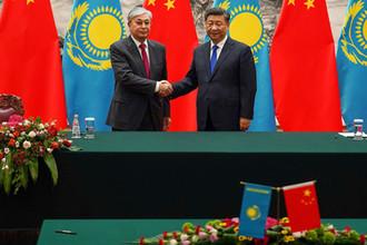 Президент Казахстана Касым-Жомарт Токаев и председатель КНР Си Цзиньпин во время встречи в Пекине, 11 сентября 2019 года