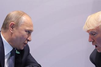 Президент России Владимир Путин и президент США Дональд Трамп во время встречи в рамках саммита G20 в Гамбурге, 7 июля 2017 года