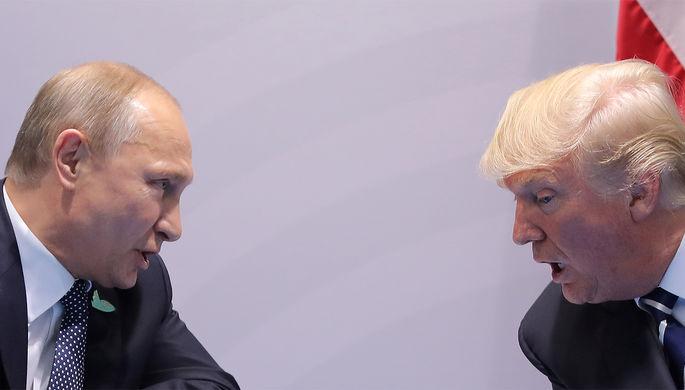 Президент России Владимир Путин и президент США Дональд Трамп во время встречи в рамках саммита G20...