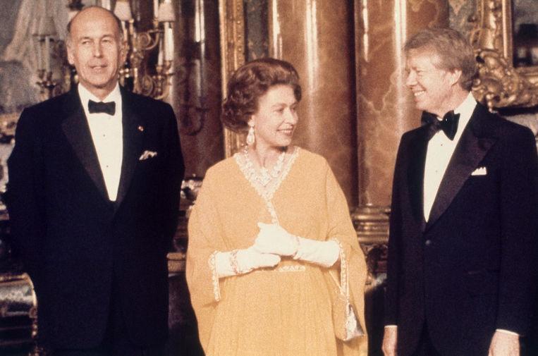 Президент Франции Жискар д'Эстен, королева Великобритании Елизавета II и президент США Джимми Картер в Букингемском дворце , 1977 год