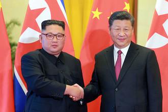 Высший руководитель КНДР Ким Чен Ын и председатель КНР Си Цзиньпин