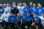 Владимир Маркин (справа навтором плане) нагала-матче, посвященном созданию Народной футбольной лиги, 2016год