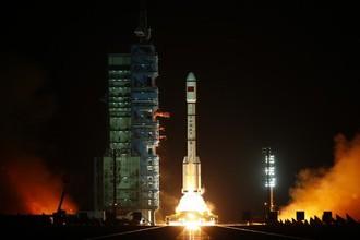 Запуск ракеты-носителя «Чанчжэн-2-ЭФ» с космическим кораблем «Тяньгун-1»