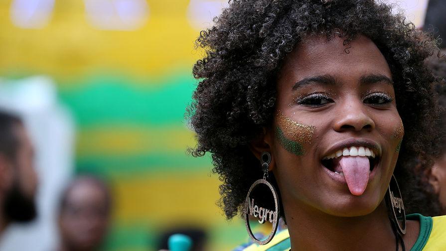 Болельщики во время матча группового этапа между сборными Швейцарии и Бразилии в Рио-Де-Жанейро, 17 июня 2018 года