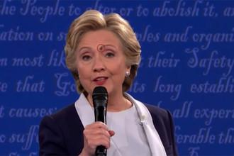 Муха на лице Хиллари Клинтон во время теледебатов